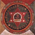 Painted 19th century Tibetan mandala of the Naropa tradition, Vajrayogini stands in the center of two crossed red triangles, Rubin Museum of Art.jpg