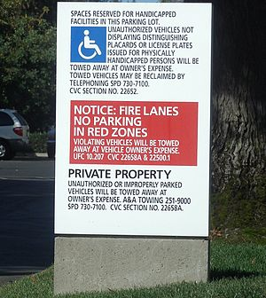 Law of the United States - Law affects every aspect of American life, including parking lots. Note the citations to statutes on the sign.