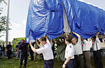 Pentagon employees join Air Force and Army personnel pitching in to help where needed after a hijacked commercial jetliner crashed into the Pentagon on September 11, 2001 010911-F-FC975-020.jpg