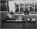 Photograph of the Texas float, honoring the birthplace of Dwight D. Eisenhower in Denison, Texas, moving past... - NARA - 200427.tif