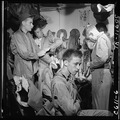 Pilots slip into flight gear aboard USS Ticonderoga (CVA-14) for strike on Manila, P.I. - NARA - 520758.tif