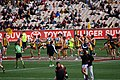 Players warming up, Hawthorn-Essendon match.jpg