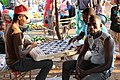 Playing a board game on the market in Chimoio.jpg