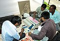 Polling officials checking the Electronic Voting Machine (EVM) and other necessary belongings for use in the West Bengal Assembly Election, at the distribution centre, in Cooch Behar on May 04, 2016.jpg