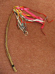Handmade whip decorated with ribbons called pomlázka