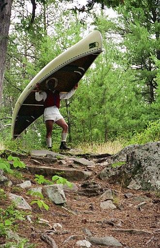 Portage - Portaging a tandem prospector in Algonquin Park