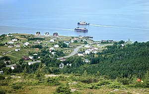 Portugal Cove-St. Philip's - Portugal Cove, NL showing the two Bell Island ferries. Holy Rosary Church can be seen at the right of the picture.