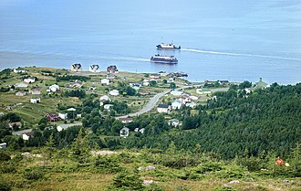 Portugal Cove–St. Philip's - Portugal Cove, NL showing the two Bell Island ferries. Holy Rosary Church can be seen at the right of the picture.
