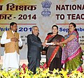 Pranab Mukherjee presenting the National Award for Teachers-2014 to Smt. Bakulaben Manibhai Bhatt, Gujrat, on the occasion of the 'Teachers Day', in New Delhi. The Union Minister for Human Resource Development.jpg