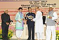 Pranab Mukherjee presenting the National Award for outstanding Services in the field of Prevention of Alcoholism and Substance (Drug) Abuse-2013 to the Youth Development Organization (YDO), Sagolband Tera Bazar, Imphal.jpg
