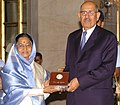 Pratibha Devisingh Patil giving away the Indira Gandhi Prize for Peace, Disarmament and Development-2008 to D.G., IAEA, Dr. Mohamed ElBaradei for his impassioned opposition to the use of Nuclear Energy for Military purpose.jpg