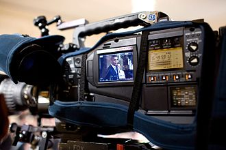 Video camera - President Barack Obama and Small Business Administration Administrator Karen Mills shown onscreen during an East Room event in the White House on 2009