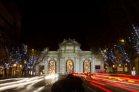 Puerta de Alcalá at night, at bottom El Retiro gardens.