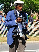 Pulitzer Prize-winning photographer John H. White at the Bud Billiken Parade 2015 (20428675015) (cropped).jpg