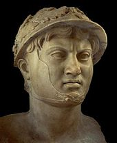 A bust of a man donned in a wreathed helmet.