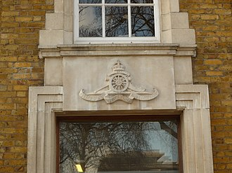 26th (London) Anti-Aircraft Brigade - Badge of the Royal Artillery above a door at a building of the former Duke of York's Headquarters