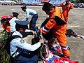 ROCA Dragon Team Crew and ROCAF Pack Men Packing Parachutes after Parachuting 20130601a.jpg
