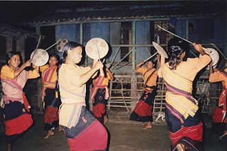 Rabha tribe - Rabha girls are dancing in their traditional costumes in a forest village in West Bengal