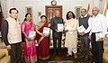 "Ram Nath Kovind being presented a special report of the Commission on ""Indira Sagar Polavaram Project Affected Tribal People"" by the Chairperson, National Commission for Scheduled Tribes (NCST), Dr. Nand Kumar Sai.JPG"
