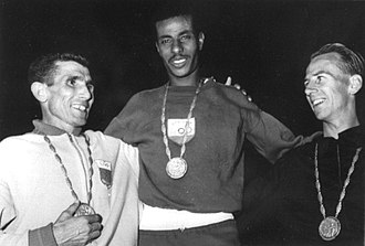 Athletics at the 1960 Summer Olympics – Men's marathon - Left-right: Rhadi Ben Abdesselam, Abebe Bikila, Barry Magee