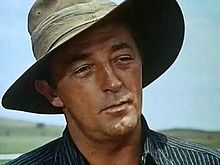 Screenshot of Robert Mitchum wearing a cowboy hat in the film The Sundowners in 1960
