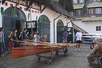 "Students of the Arndt-Gymnasium, standing in front of their ""rowing house"", christening their new boat in 2007 Ruderboottaufe-agd-rudererhaus.jpg"