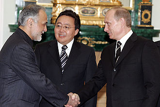 Shanghai Cooperation Organisation - Putin with representatives from Iran and Mongolia, observers in the SCO, at a meeting of the Council of Heads of Government in 2005.