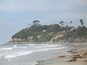 Autobiography of a Yogi - Looking north along Swami's beach in Encinitas, showing part of the Self Realization Fellowship's ashram on the point, including (on the left) the hermitage where Yogananda wrote Autobiography of a Yogi