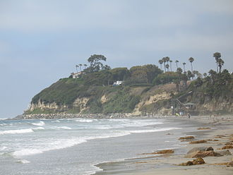 "Self-Realization Fellowship - A 2007 view looking north along Swami's beach in Encinitas, the red-roofed building on top of the point is the hermitage where Yogananda wrote ""Autobiography of a Yogi"""