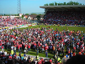 Swindon Town F.C. - Town fans celebrating promotion on the county ground pitch after the draw with Walsall 2006–07 season
