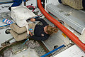 STS-135 Sandy Magnus with a cargo transfer bag.jpg