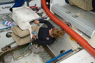 Toe socks - Sandra Magnus in toe socks (STS-135).