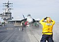 Sailor directs a Super Hornet at sea. (8719463949).jpg