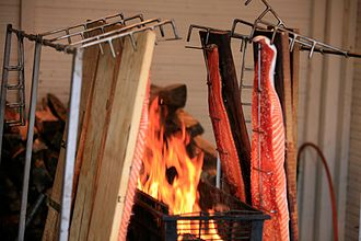 Indirect grilling - One method of plank cooking salmon steaks.