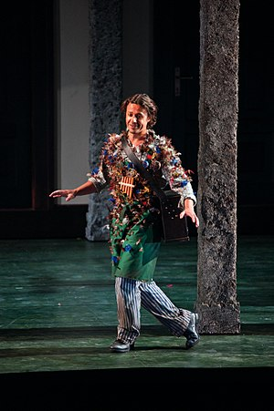 The Magic Flute - Baritone Markus Werba appearing as Papageno. He wears his pipes and carries his magic bells; both instruments are essential to the plot.
