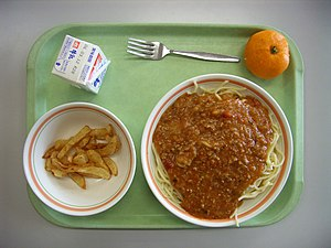 A Japanese elementary school lunch. Spaghetti,...