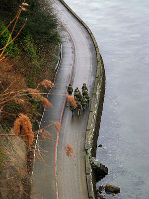 Seawall (Vancouver) - Reserve soldiers walking on the pedestrian side of the seawall, near Siwash Rock in Stanley Park.