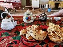 Serving guests in Turpan.jpg