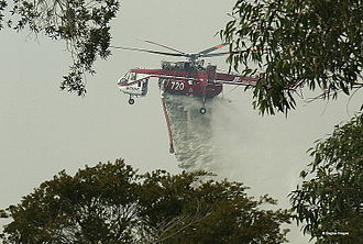 New South Wales Rural Fire Service - Shania (N720HT), nicknamed Elvis, dropping water during bushfires in the region on 30 April 2007.