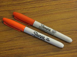 "Counterfeit - A Sharpie marker, next to a counterfeit ""Shoupie"" marker"