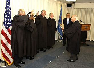 Anthony A. Alaimo - Defense Secretary Donald H. Rumsfeld (rear) observes as Judge Anthony Alaimo, administers the oath office to the first Military Commissions Review Panel on September 21, 2004 at The Pentagon