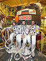 Soyuz TMA-01M Crew in front of the capsule.jpg