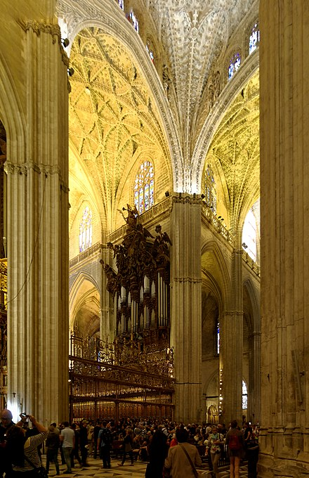 Interior of the Seville Cathedral, showing the pipes of the organ. Spain Andalusia Seville BW 2015-10-23 12-30-25 stitch.jpg