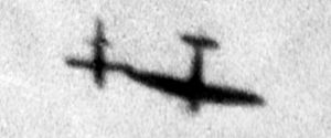 Operation Crossbow - A Spitfire tipping the wing of a V-1 to disrupt the missile's automatic pilot.
