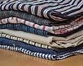 Stack-of-mens-ironed-casual-shirts.jpg