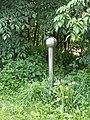 Stainless street post in the trees, Turku.jpg