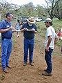 Starr-030409-0048-Erythrina sandwicensis-fence blessing with Bob-Puu o Kali-Maui (24334708330).jpg