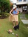 Starr-140925-1957-Musa textilis-Angela with woven skirt and Pukiki cat-Pali o Waipio Huelo-Maui (24619726653).jpg