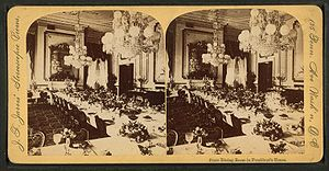 State dinner - The State Dining Room at the White House as depicted in this 1850s stereoscopic view. Long banquet tables were used for state dinners before they were discarded in the 1960s by First Lady Jacqueline Kennedy in favor of round tables.