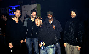 The 5 members of Stateless posing side-by-side on a dark background.